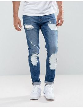 Asos Skinny Jeans In Mid Wash Blue With Rip And Repair by Asos