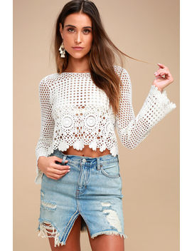 Relaxed &Amp; Destroyed Light Wash Distressed Denim Mini Skirt by Free People