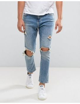 Bershka Skinny Tapered Jeans With Rips In Mid Wash by Bershka