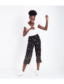 Black Floral Border Print Plisse Trousers by New Look