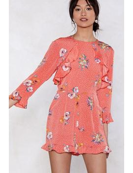 Bright Spot Floral Romper by Nasty Gal