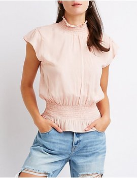 Smocked Mock Neck Peplum Top by Charlotte Russe