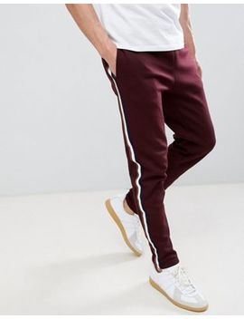 River Island Joggers With Side Tape Detail In Burgundy by River Island